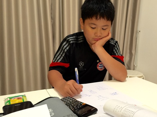 eduKate Singapore Punggol Tuition Centre Secondary 1 Montfort Secondary student doing E Mathematics in Prive
