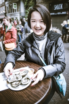 Tutor Yuet Ling at Borough Market, London. Oysters at the street side. After a course in Cambridge University.
