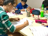 Tutors marking student's work in Primary English. We make sure they do their work correctly.